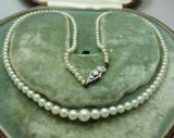 Pretty set of art deco neat  cultured pearls with white gold snap